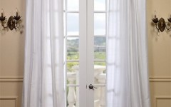 Beautiful silk drapes are perfect for the dining area of a house.