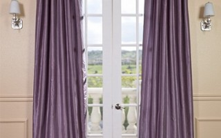 Bring texture into your living room through purple drapes.