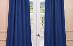 Cotton or linen drapes are great for hiding your personal office space in your off-campus apartment.