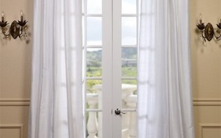 Even white curtains can help insulate and shade your home.