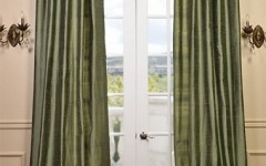 Green textured silk curtains are great for an indoor/outdoor space.