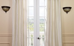 Lengthier silk drapes can add elegance to your home.
