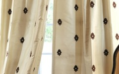 Lovely fine window treatments like this are fantastic for a small kitchen.