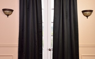 Make black drapes pop with metallic home accessories.