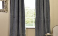 Neutral grey velvet blackout drapes like these are well suited to an industrial space.