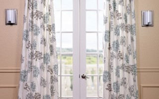 Patterned drapes catch the sun beautifully.
