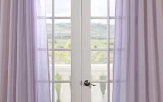 Sheer curtains are helpful for decorating in small outdoor spaces.