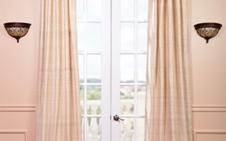 Silk curtains exude a romantic vibe.