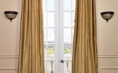 Silk, gold curtains are perfect for warm-tone rooms.