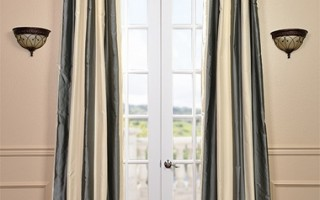 Striped drapes like this do a great job conveying a New England aesthetic.