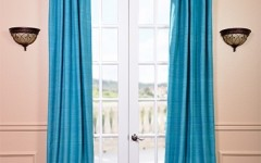 These beautiful blue drapes are right on trend with Southwestern home decor.