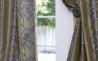 These silk drapes have a pattern inspired by chintz, meaning they'll look great in your home for years to come.