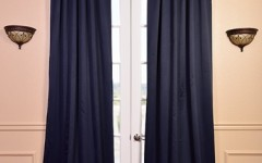 Tranquil blue drapes will make your bedroom into an oasis.