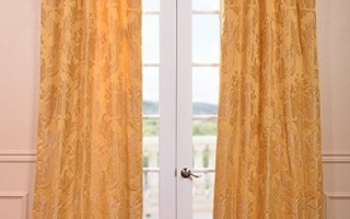 Try accenting your white walls with gold curtains.