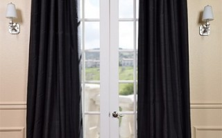 Try adding black curtains to create a trendy Mod look in your home.