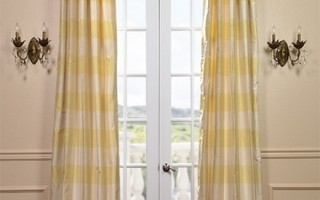 Use beautiful silk curtains to help dress down your living space.