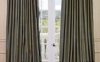 Using banded silk drapes on either side of your corner windows will help to ensure their beauty.